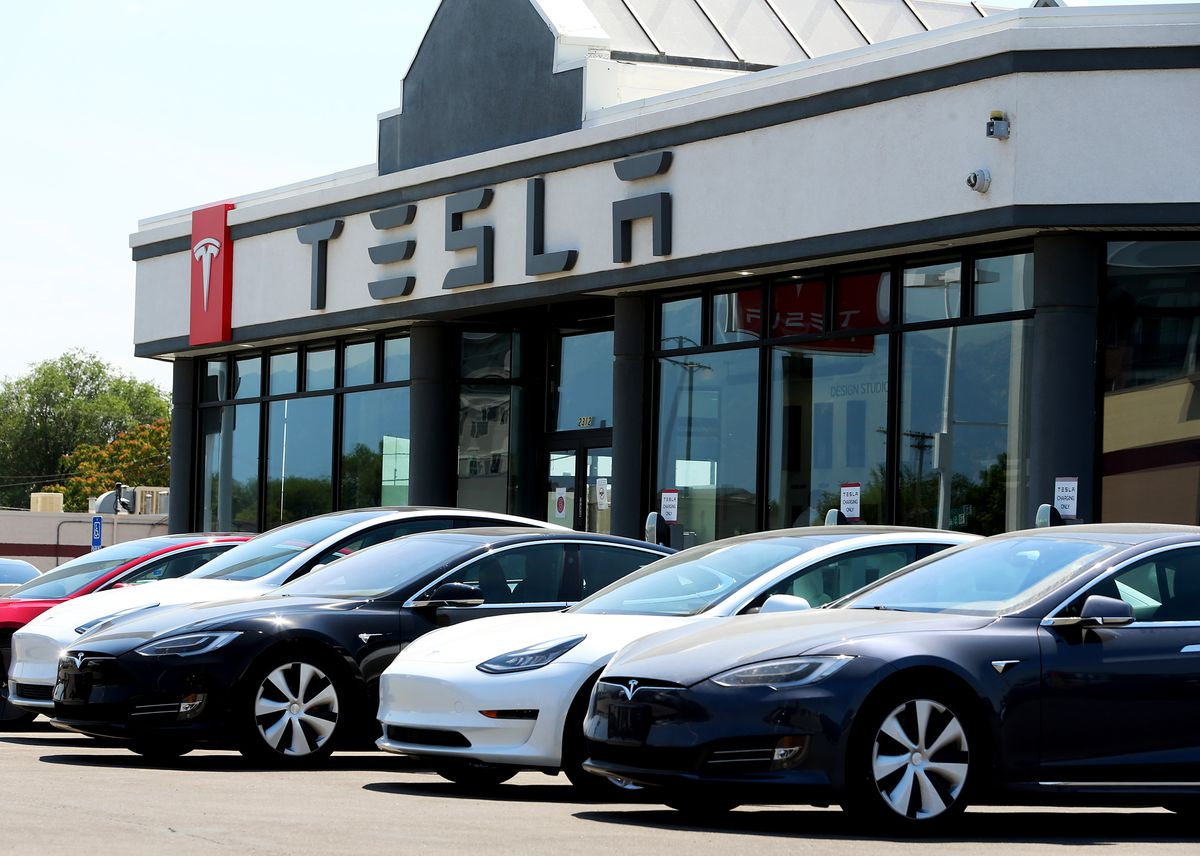 """The Tesla dealership in Salt Lake City is pictured on Tuesday, July 21, 2020. A new report from Wells Fargo shows U.S. retail volumes are nearly back to pre-pandemic levels, even though the list of """"winners"""" and """"losers"""" has changed dramatically due to fallout from COVID-19."""