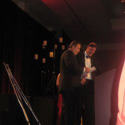 Scott Drewno and Robert Wiedmaier present the chef of the year award.