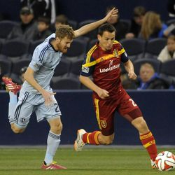 Real Salt Lake's Luis Gill races past the defense of Sporting KC's Oriol Rosell during a game at Sporting Park in Kansas City, Kan., on Saturday, April 5, 2014.