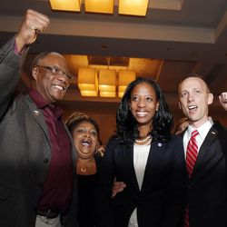 Mia Love, 4th Congressional District Republican candidate, declares victory on election night in Salt Lake City, Tuesday, Nov. 4, 2014. At left is her father, Maxime Bourdeau, mother Marie Bourdeau, and at right is her husband, Jason.