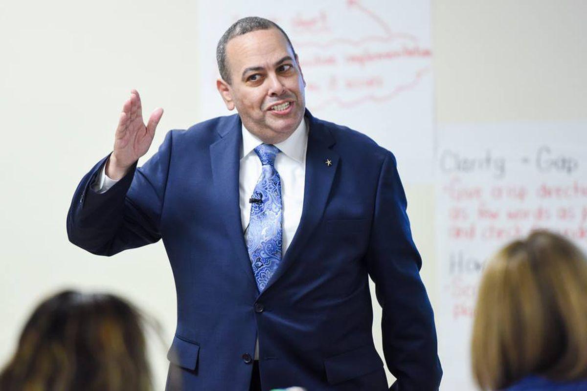 Superintendent Roger León  speaking to educators at a Newark charter school last year.
