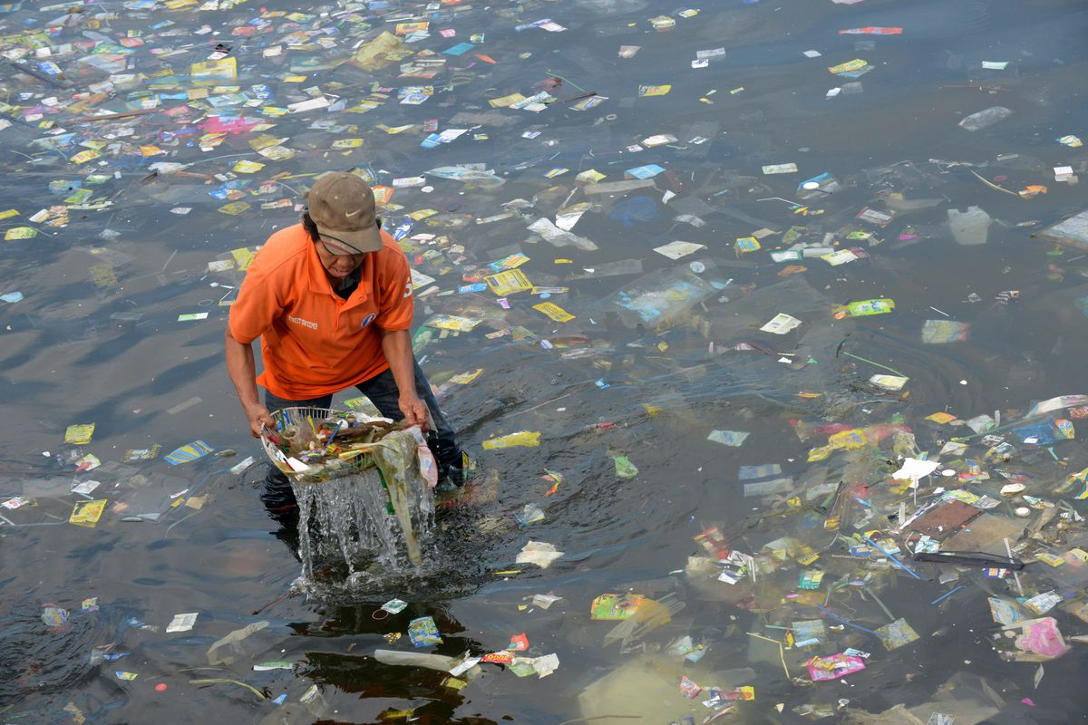Someone collects trash in the Philippines