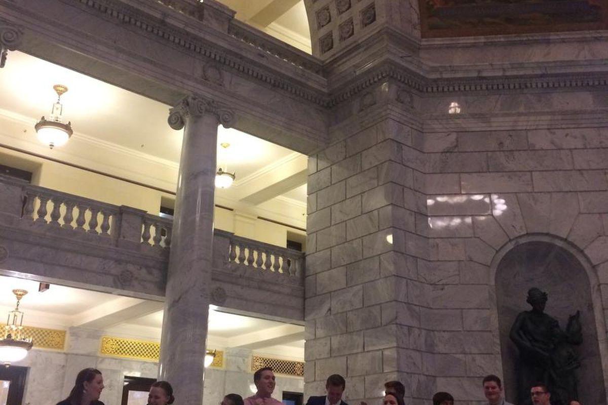 Utah legislative interns sing with Matt Hillyard at his karaoke party in the Capitol rotunda Tuesday, February 9, 2016.