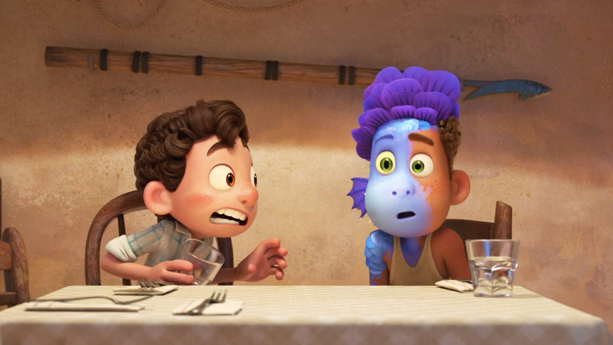 A boy spits on his friend and turns him into a sea monster at the dinner table in Luca