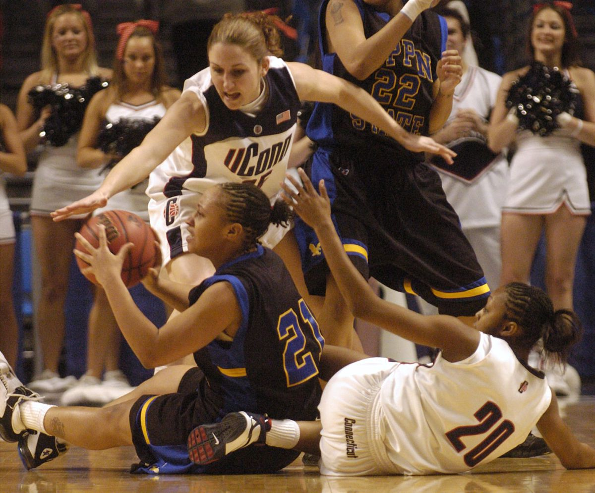 Coppin State's Talia Sutton (21) is pressured by Connecticut