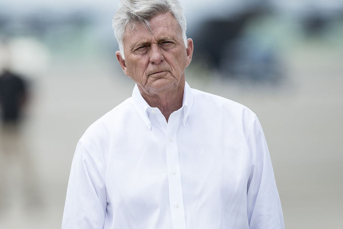 Arkansas Governor Mike Beebe poses after touring tornado-struck areas in his state.