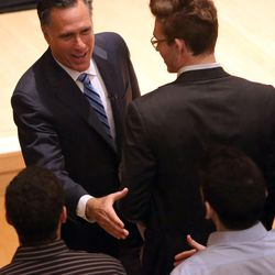 Mitt Romney, former governor of Massachusetts, shakes hands after addressing the Hinckley Institute of Politics at the University of Utah in Salt Lake City on Thursday, March 3, 2016, regarding the state of the 2016 presidential race.
