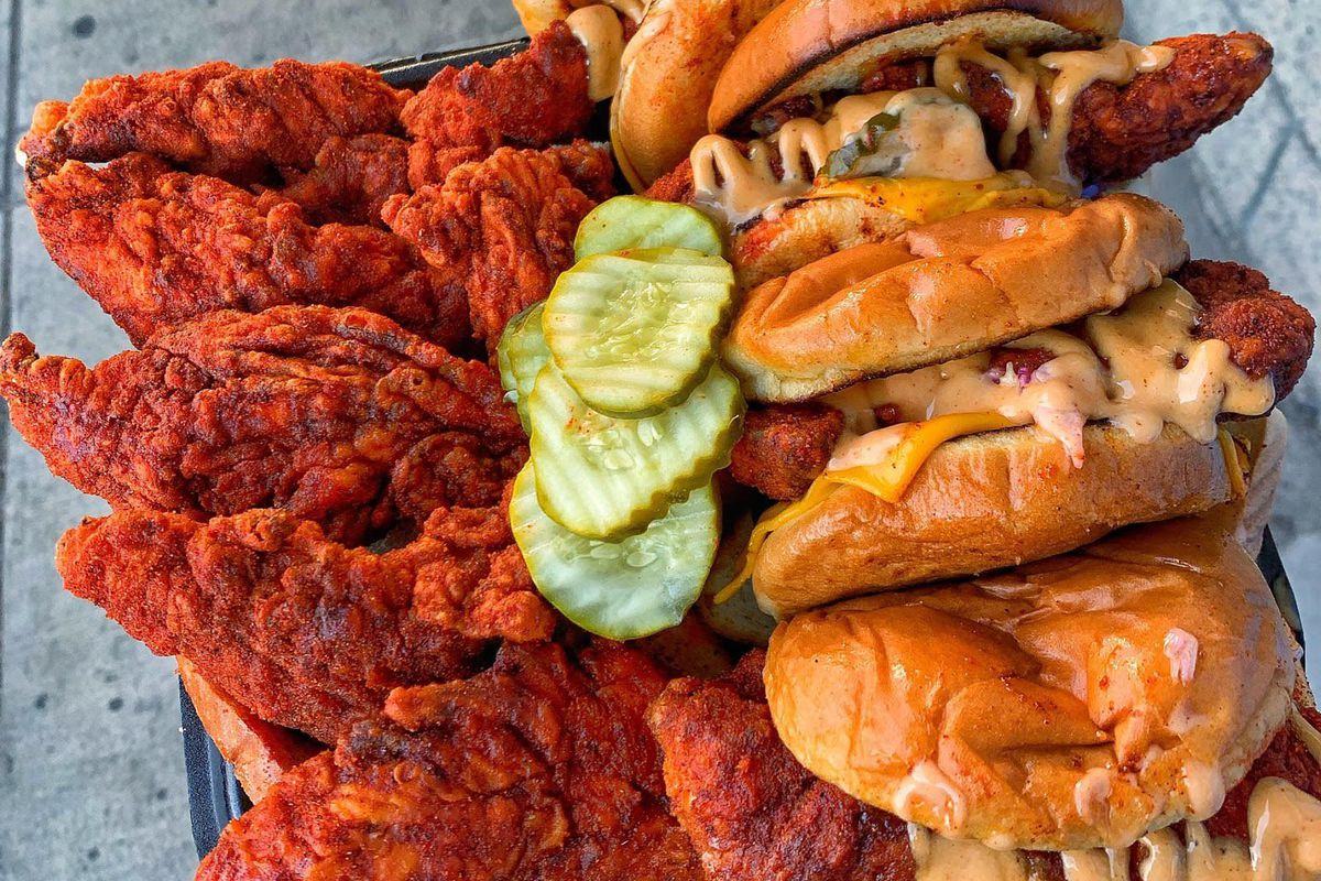 a tray of hot chicken tenders and sliders