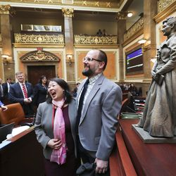 House Minority Caucus ManagerKaren Kwan, D-Murray, laughs with artist Ben Hammond and his bronze statue depicting former state Sen. Martha Hughes Cannon on the House floor at the Capitol in Salt Lake City on Tuesday, Jan. 28, 2020. The statue is a 25-inch replica of the 7-foot-6-inch statue that will represent Utah at the U.S. Capitol's National Statuary Hall.