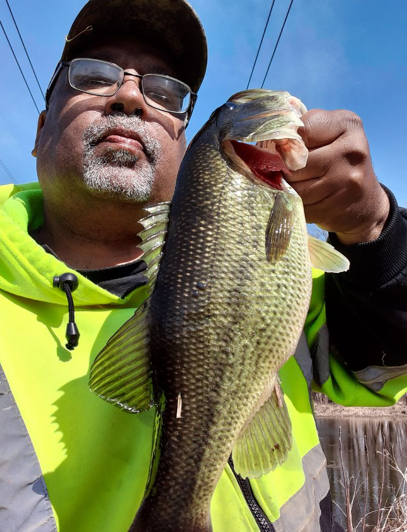 Victor Blackful with a Kankakee River largemouth bass. Provided photo