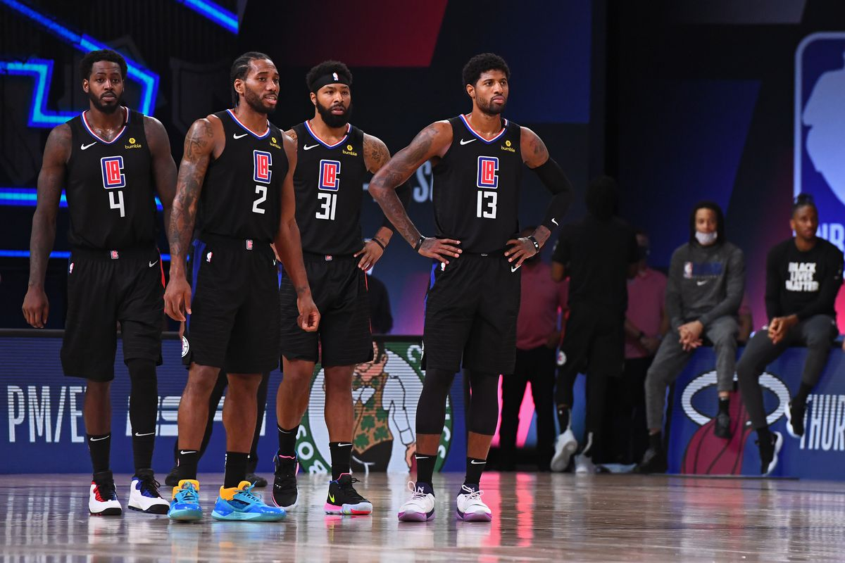 The LA Clippers stand on the court during Game Seven of the Western Conference Semifinals of the NBA Playoffs against the Denver Nuggets on September 15, 2020 in Orlando, Florida at AdventHealth Arena.