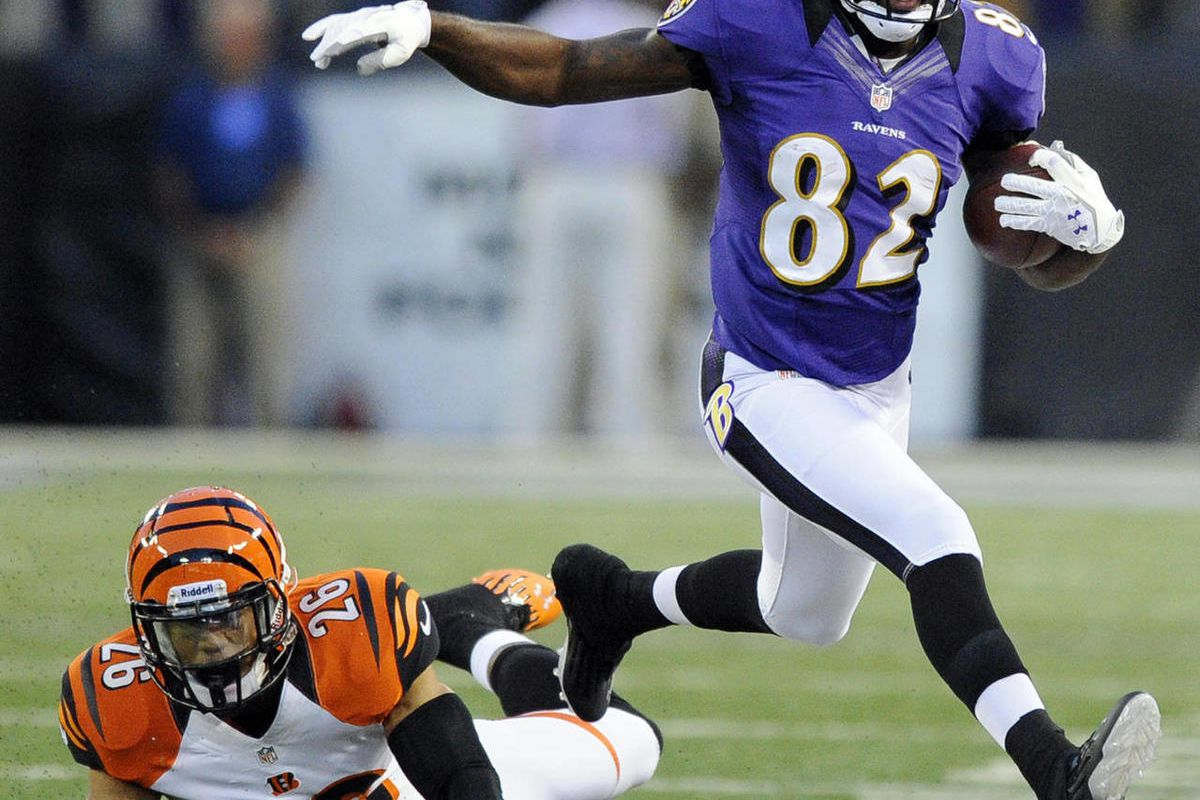 Baltimore Ravens wide receiver Torrey Smith (82) is chased out of bounds by Cincinnati Bengals safety Taylor Mays in the first half of an NFL football game in Baltimore, Monday, Sept. 10, 2012.