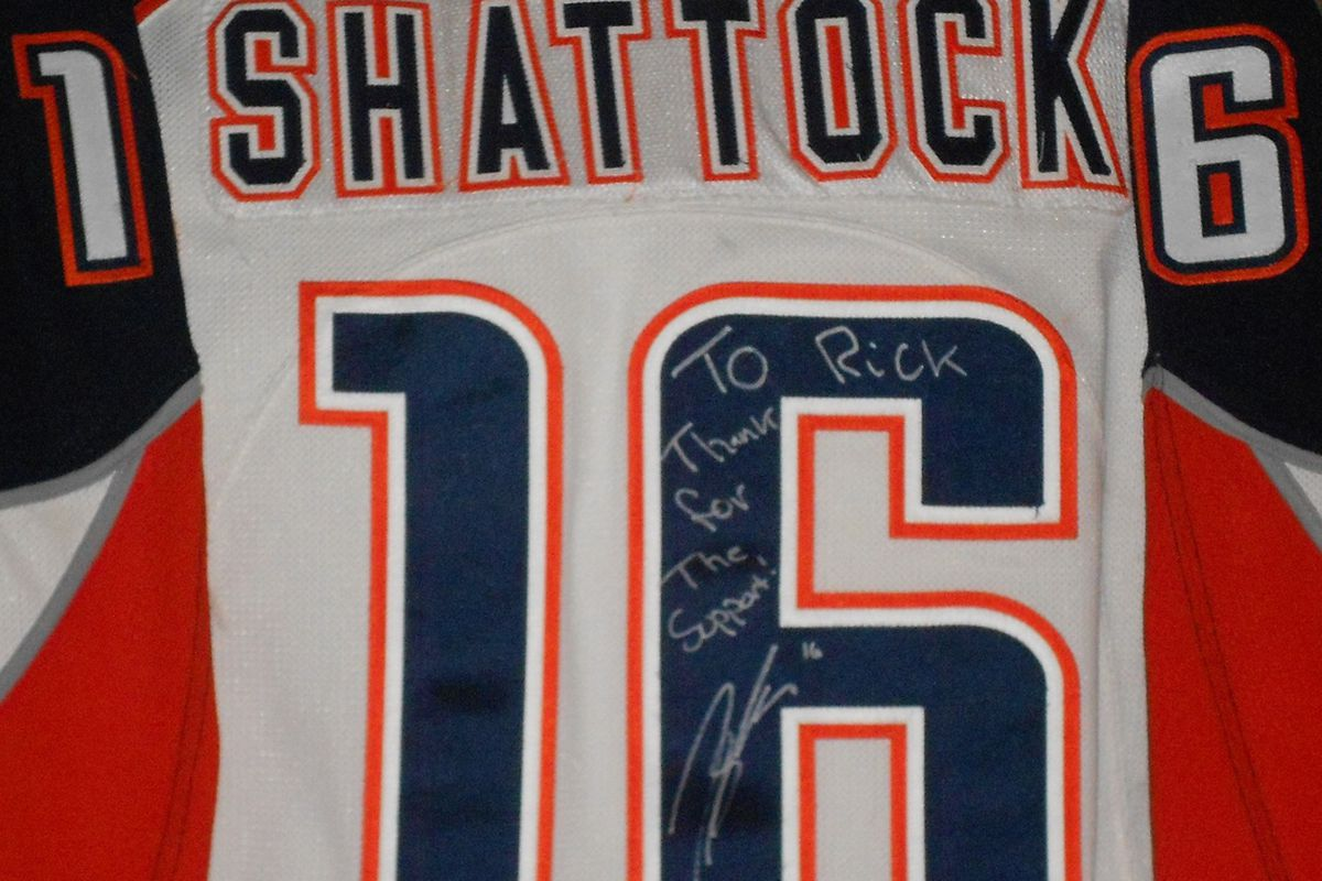 Game worn, signed Tyler Shattock (Blues prospect with the Chicago Wolves) jersey from Kamloops Blazers, the nearest WHL city to Vancouver. Front signed by Ken Hitchcock, who began his coaching career in Kamloops.