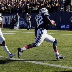 Brigham Young Cougars running back Squally Canada runs in for a touchdown with San Jose State Spartans safety Maurice McKnight defending during NCAA football in Provo on Saturday, Oct. 28, 2017.