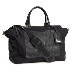 """A simple but not basic take on the weekender. <a href=""""http://www.hm.com/us/product/15399?article=15399-A"""">Canvas Weekender Bag</a>, $39.95 at H&M."""