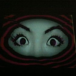 There was a room completely in the dark, with only these eyes glaring back at you