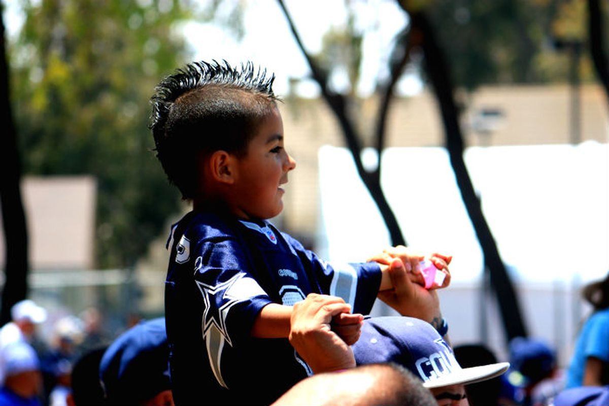 A young fan enjoys the first day of Cowboys camp in Oxnard.