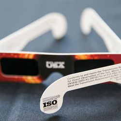 A pair of glasses with the ISO certification that indicates they are safe to use during a solar eclipse is displayed at the John A. Moran Eye Center in Salt Lake City on Wednesday, Aug. 2, 2017. Moran Eye Center locations are giving away 1,000 free pairs of the glasses.