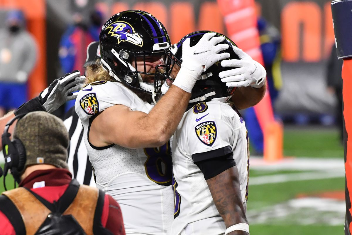Baltimore Ravens quarterback Lamar Jackson (8) celebrates with tight end Luke Willson (82) after he scored a touchdown during the first quarter against the Cleveland Browns at FirstEnergy Stadium.