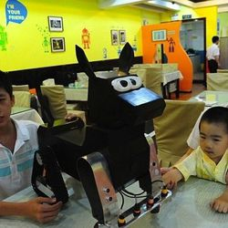 """<span class=""""credit""""><em>[Photo: <a href=""""http://www.dailymail.co.uk/sciencetech/article-2165339/Serving-humanity-diner-time-Chinese-restaurant-robot-staff-delights-noodle-lovers.html"""">Rex Features</a>]</em></span>"""