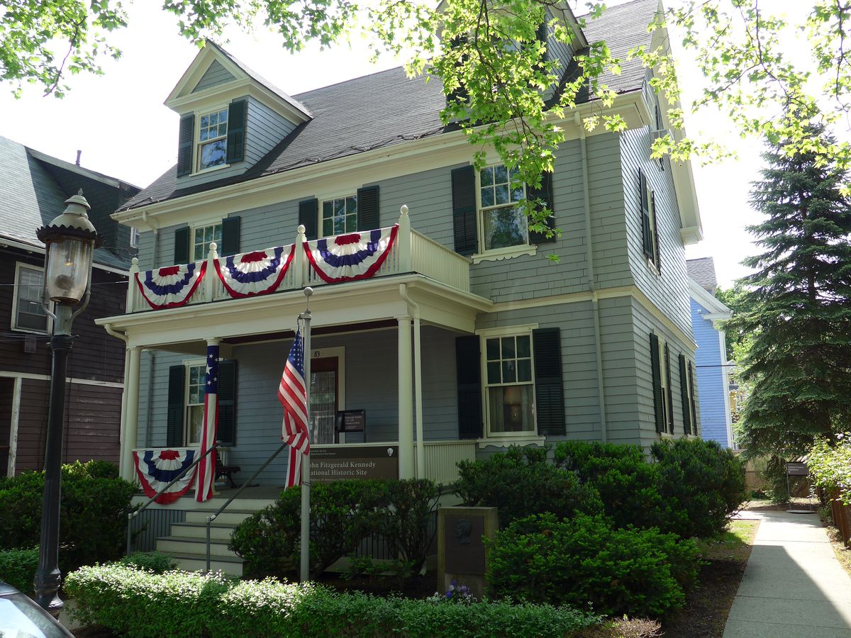 A three-story house with bunting.