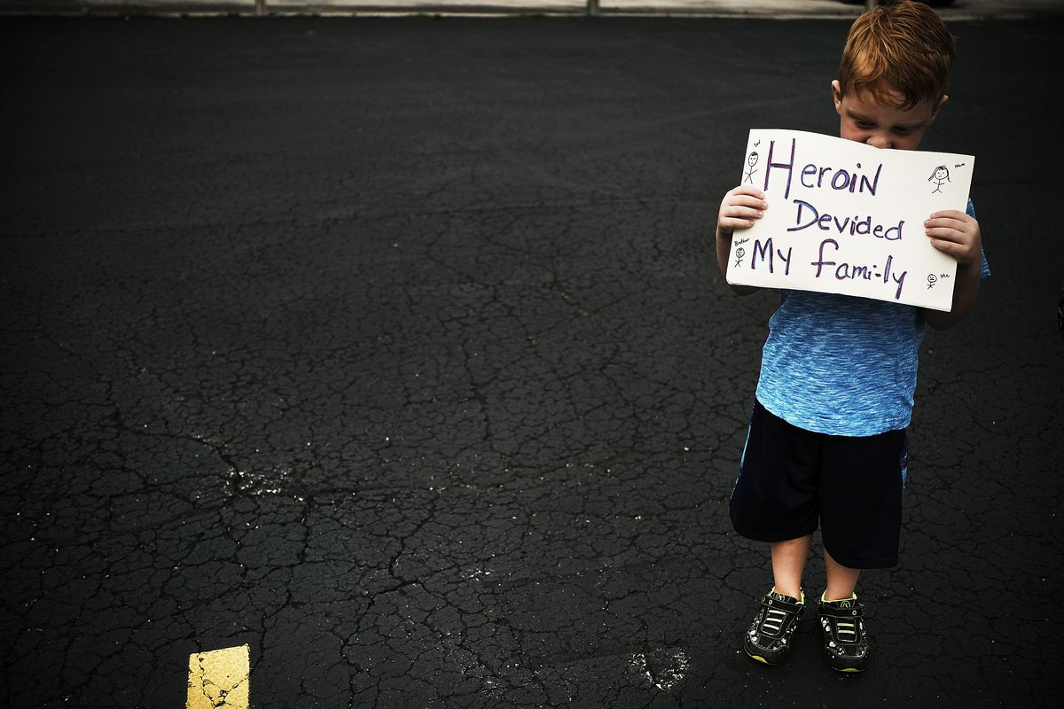 A boy attends a march against the opioid epidemic with his grandmother in Norwalk, Ohio, on July 14, 2017.