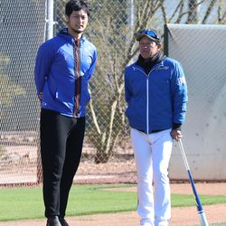 Yu Darvish stands with Nippon-Ham Fighters head coach Hideki Kuriyama during a Spring Training workout at Salt River Fields in Scottsdale, AZ.   John Antonoff/For the Sun-Times