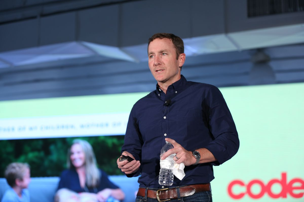 John Foley, founder and CEO of Peloton, speaking onstage at Code Commerce