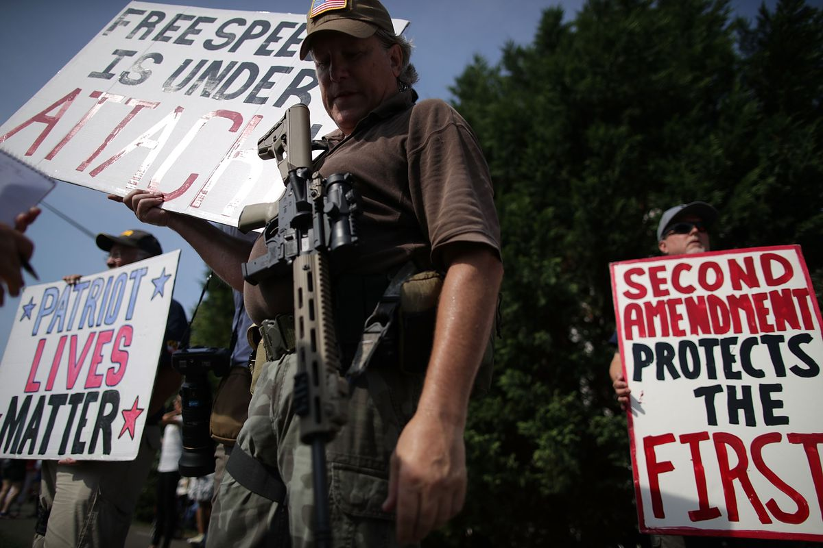 Armed gun rights activists counter-protest during a gun-control rally outside the headquarters of National Rifle Association.