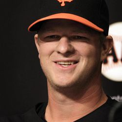 San Francisco Giants pitcher Matt Cain smiles during a news conference Monday, April 2, 2012, in San Francisco. Cain and the Giants agreed Monday to a $127.5 million, six-year contract, the largest deal for a right-handed pitcher in baseball history. The agreement adds $112.5 million over five years to the $15 million salary for 2012 that was remaining in his previous deal.