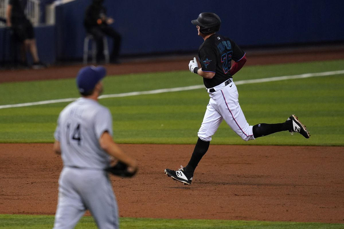 Miami Marlins right fielder Garrett Cooper (26) rounds the bases after hitting a solo homerun off of Tampa Bay Rays starting pitcher Rich Hill (14) in the 3rd inning at loanDepot park.