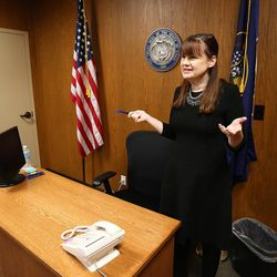 Patricia Abbott Lammi shows their hearing room at her work at the Utah Health Department on Tuesday, May 2, 2017. Patricia and her husband Phillip work to juggle their work schedules to make things work.