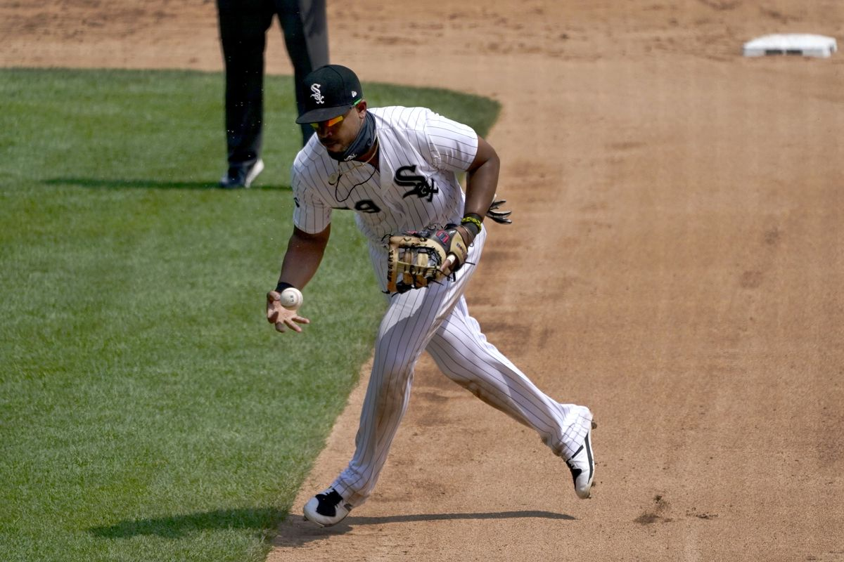 Chicago White Sox first baseman Jose Abreu makes a fielding error on a ground ball hit by St. Louis Cardinals' Tommy Edman, allowing Dexter Fowler to score during the fourth inning in Game 1 of a double-header baseball game Saturday, Aug. 15, 2020, in Chicago. (AP Photo/Charles Rex Arbogast)