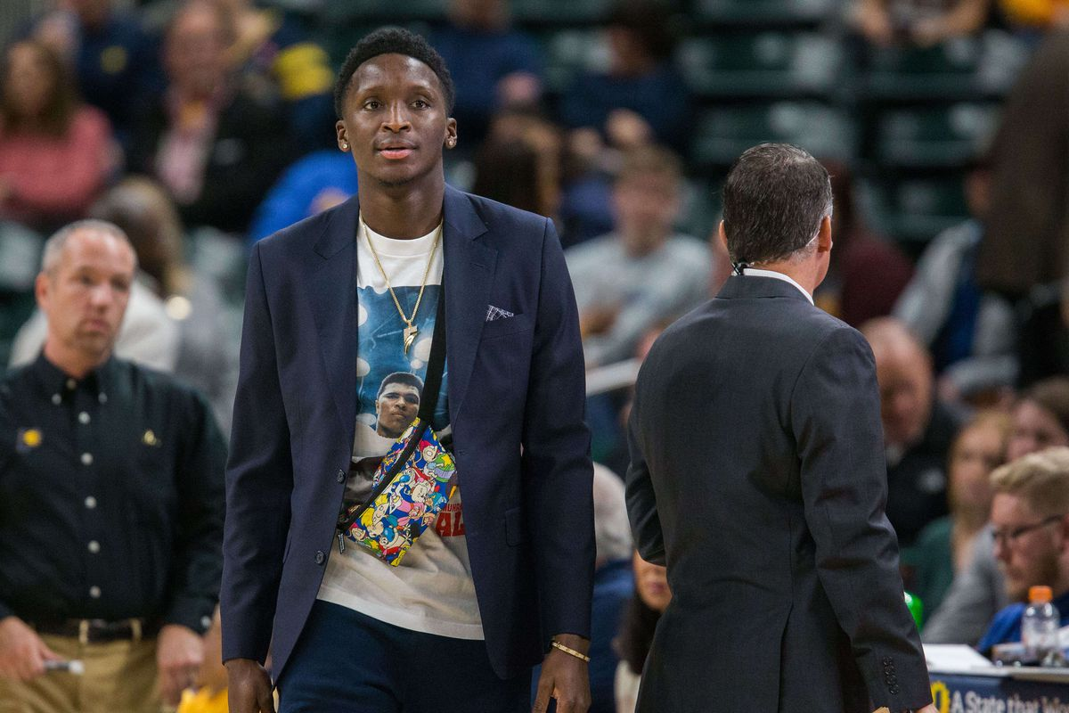 Indiana Pacers guard Victor Oladipo watches the game from the sideline in the first half against the Orlando Magic at Bankers Life Fieldhouse.
