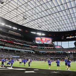BYU football players warm up in Allegiant Stadium prior to the Vegas Kickoff Classic between BYU and Arizona in Las Vegas on Saturday, Sept. 4, 2021.