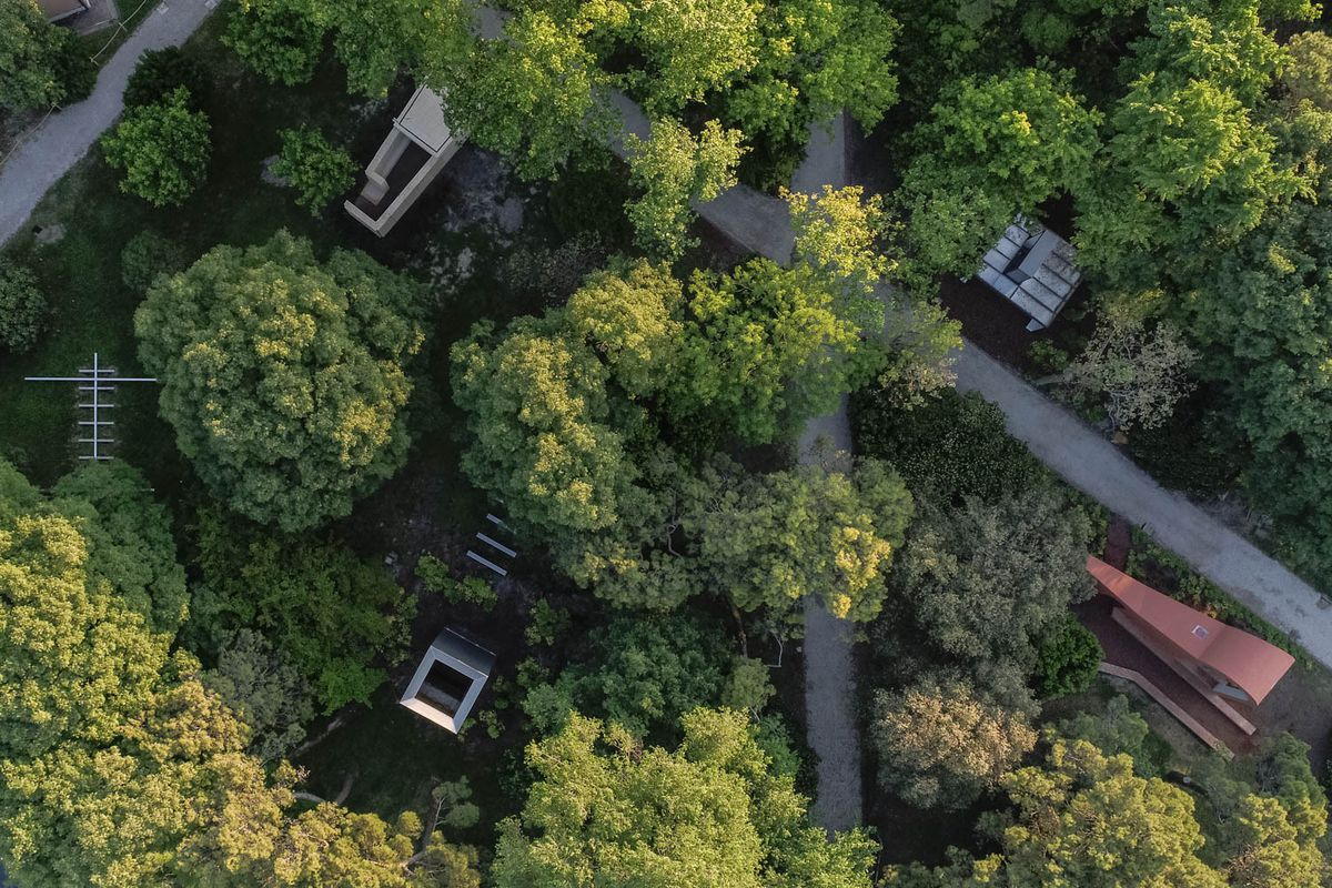 Aerial shot of chapels in forest