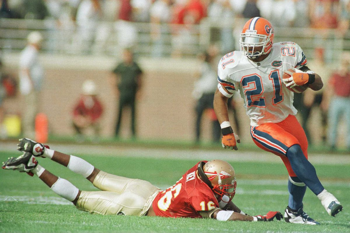 Fred Taylor eludes the tackle of Sean Kelly in 1996.