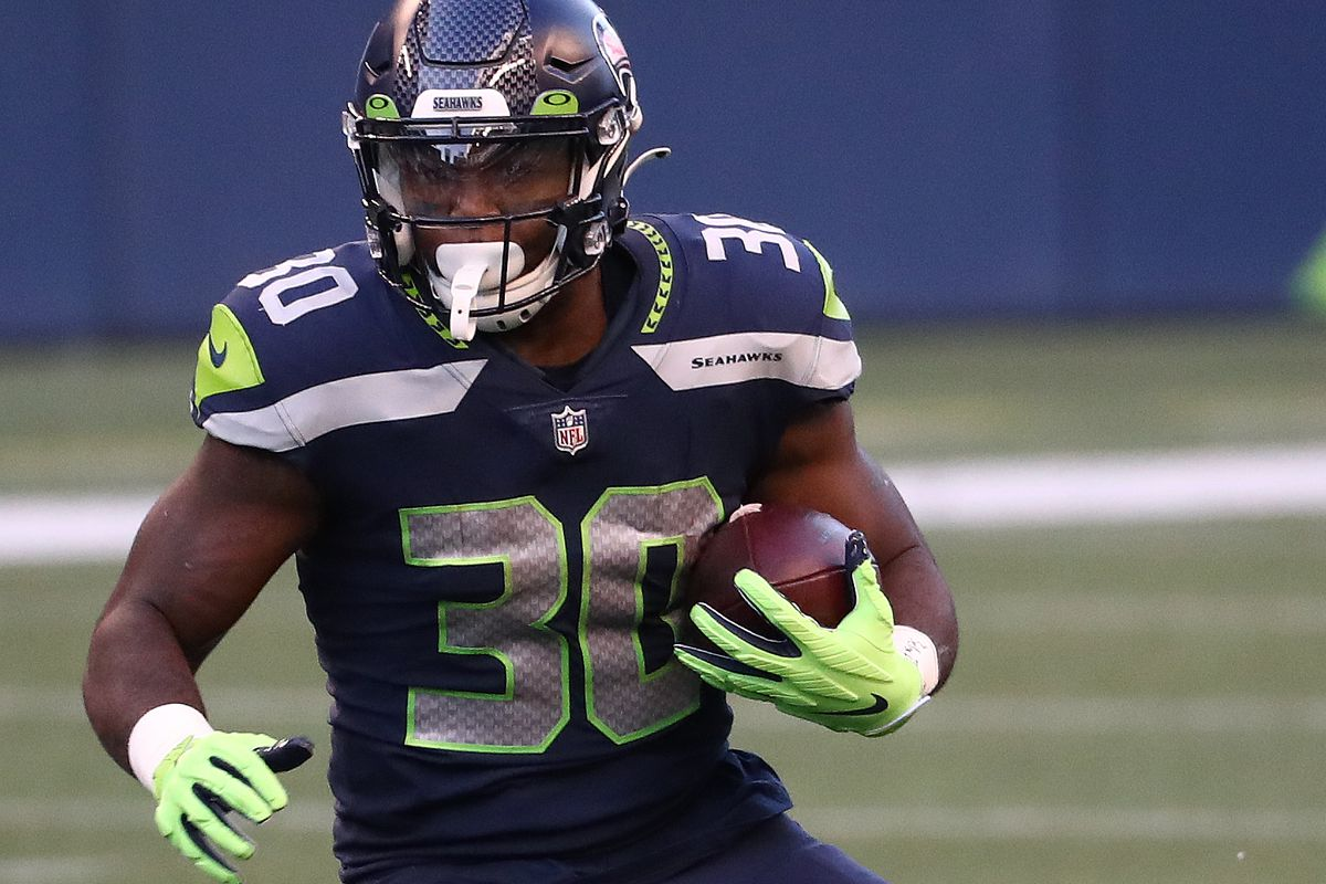 Carlos Hyde #30 of the Seattle Seahawks runs with the ball in the second quarter against the New England Patriots at CenturyLink Field on September 20, 2020 in Seattle, Washington.