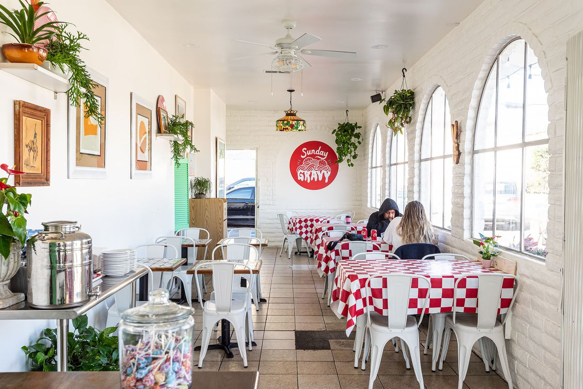 Dining room at Sunday Gravy in Inglewood with white tables.
