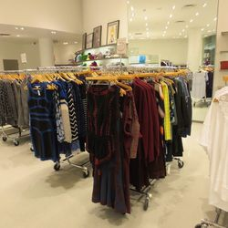 Five racks of women's clothing is marked down an additional 50 percent off.