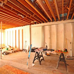Uncle's open kitchen will be built against this wall.