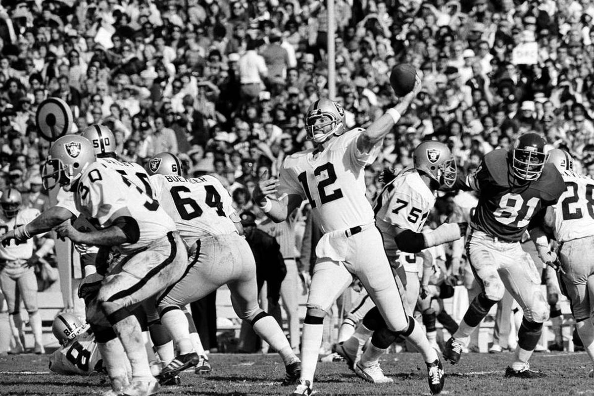 George Buehler and the Raiders offensive line blocking for Ken Stabler in Super Bowl XI versus the Vikings