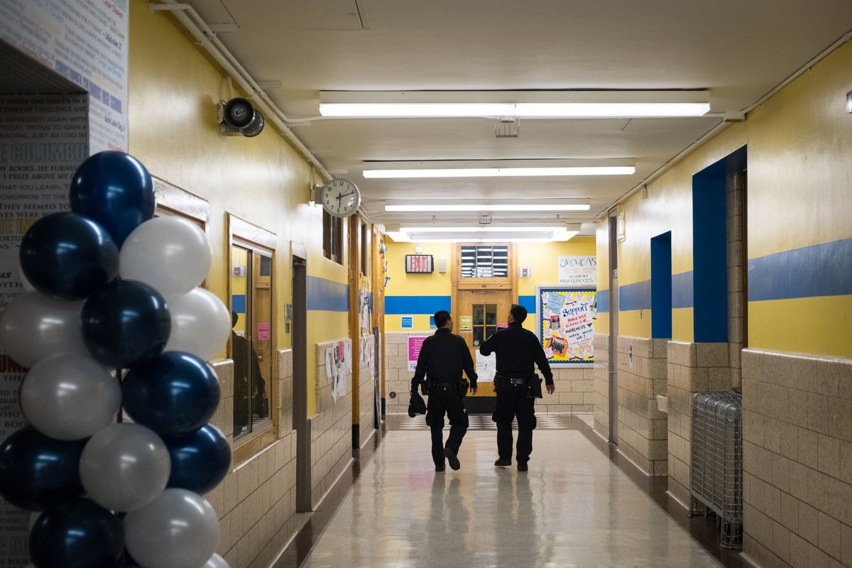 School safety officers walk down a hallway at Christopher Columbus Campus, Nov. 19, 2016.