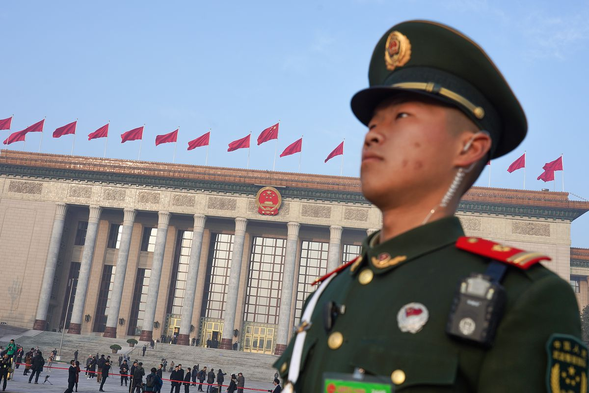 A soldier stands in Tiananmen Square in front of the Great Hall of The People before the opening of the 13th National People's Congress on March 5, 2019 in Beijing, China.