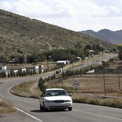 A car passes through Colonia LeBaron, one of many locations where the extended LeBaron family lives in the Galeana municipality of Chihuahua state in northern Mexico, on Tuesday, Nov. 5, 2019. Drug cartel gunmen ambushed on Monday three vehicles along a road near the state border of Chihuahua and Sonora, slaughtering at least six children and three women from the extended LeBaron family, all of them U.S. citizens living in northern Mexico, authorities said Tuesday.
