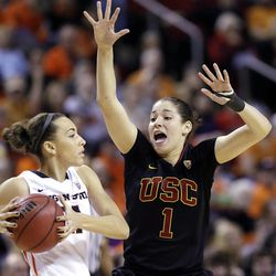Oregon State's Gabriella Hanson, left, looks for room to pass around the defense of Southern California's Jordan Adams in the second half of the Pac-12 NCAA college championship basketball game Sunday, March 9, 2014, in Seattle.  USC won 71-62. (AP Photo/Elaine Thompson)