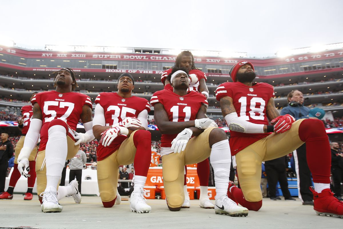 Members of the San Francisco 49ers kneel in protest. Michael Zagaris San  Francisco 49ers Getty Images ... 34414751f