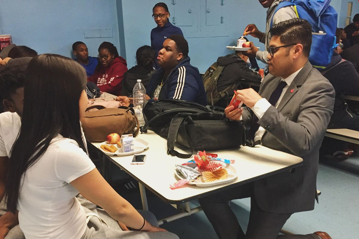 Principal Manalo shares candy and jokes with students in the school cafeteria