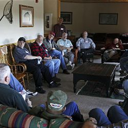 """Cancer patients share stories with one another in one of the """"courageous conversation"""" sessions during the Reel Recovery retreat at Falcon's Ledge lodge near Altamont."""