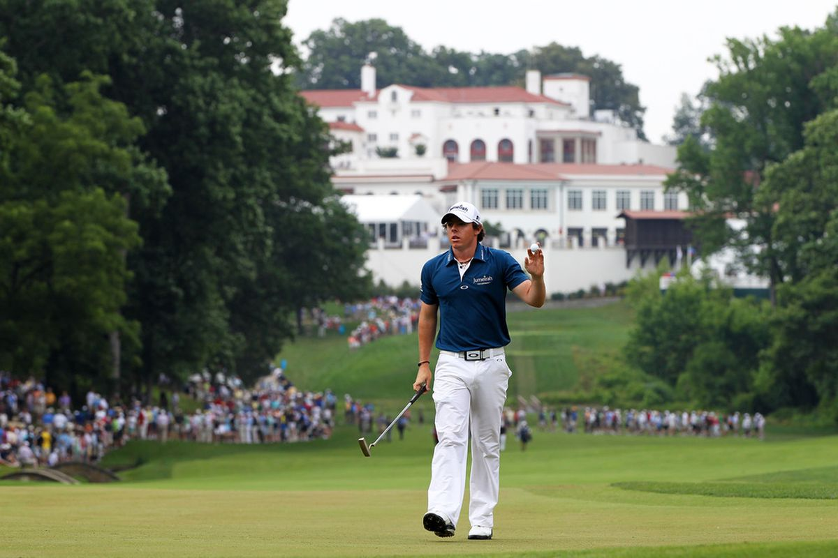 BETHESDA, MD - JUNE 16:  Rory McIlroy of Northern Ireland waves to the gallery on the 11th green during the first round of the 111th U.S. Open at Congressional Country Club on June 16, 2011 in Bethesda, Maryland.  (Photo by Jamie Squire/Getty Images)